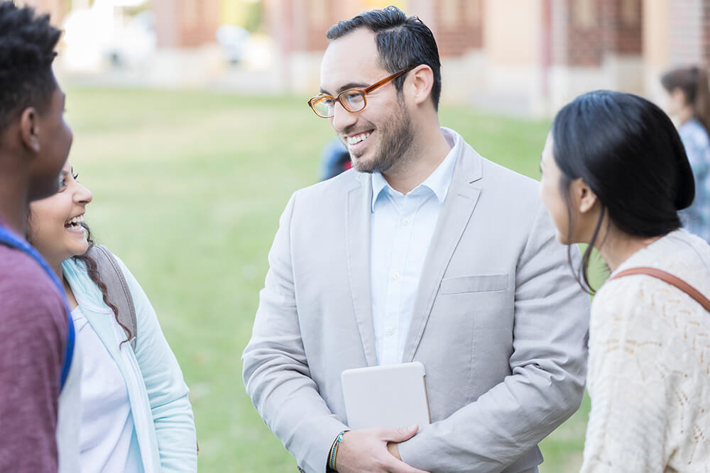 professor talking with students