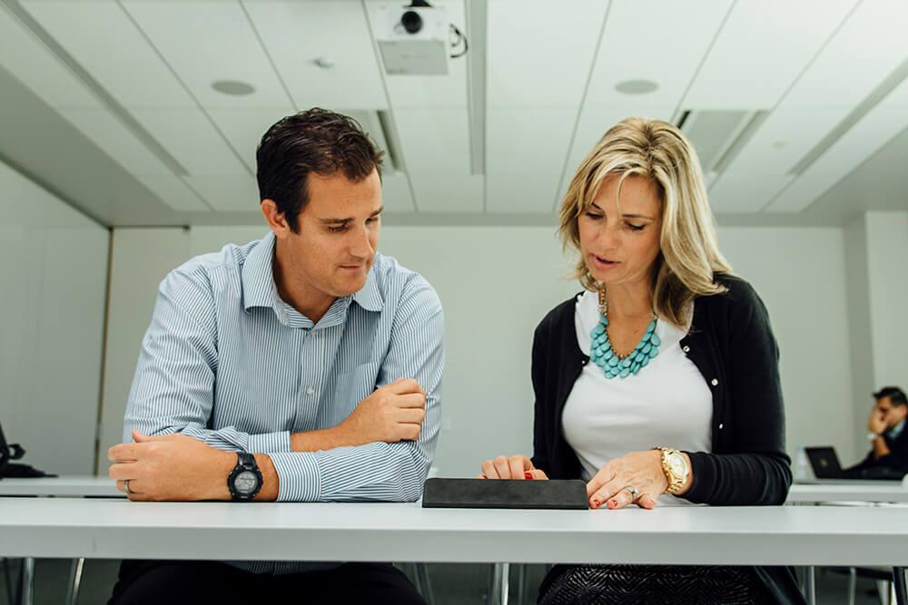 M.Ed. Leadership students using an iPad